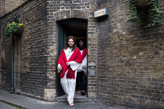 Luigi Pertrilli walks out of a public toilet during the Christathon X pub crawl on April 16, 2017 in London, England. The Christathon pub crawl is celebrating its tenth year this year and sees participants dress as Jesus and visit pubs on Easter Sunday around the British capital whilst donating collections from those involved to the charity Save the Children. (Photo by Chris J. Ratcliffe/Getty Images)