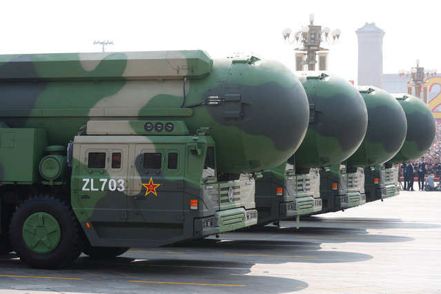 Military vehicles carrying the DF-41 intercontinental nuclear missile roll past Tiananmen Square during a military parade marking the 70th anniversary of the founding of the People's Republic of China, in Beijing, China, 01 October 2019. China commemorates the 70th anniversary of the founding of the People's Republic of China on 01 October 2019 with a grand military parade and mass pageant. (Photo by Wu Hong/EPA/EFE)