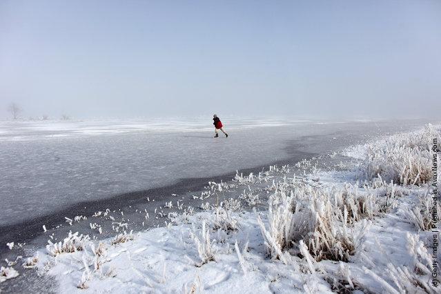 Enthusiasts skate on a frozen fen in sub-zero temperatures