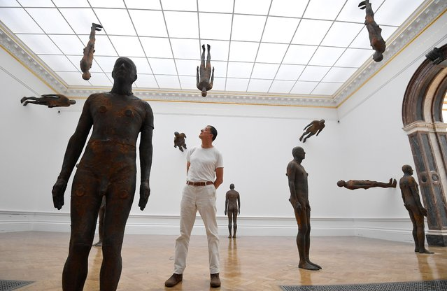 "British sculptor Antony Gormley poses with his installation ""Matrix III"" ahead of his exhibition at Royal Academy of Arts on September 16, 2019 in London, England. (Photo by Toby Melville/Reuters)"