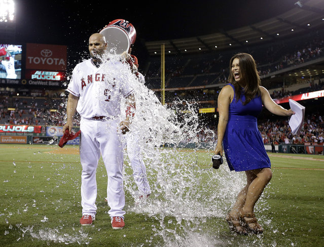 Los Angeles Angels' Albert Pujols is doused with liquid by teammate Mike Trout after the Angels' 7-3 win over the Boston Red Sox in the second baseball game in a doubleheader, Monday, July 20, 2015, in Anaheim, Calif. (Photo by Jae C. Hong/AP Photo)
