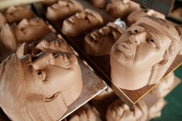 Masks of U.S. Republican presidential candidate Donald Trump are seen drying on shelves at Jinhua Partytime Latex Art and Crafts Factory in Jinhua, Zhejiang Province, China, May 25, 2016. (Photo by Aly Song/Reuters)