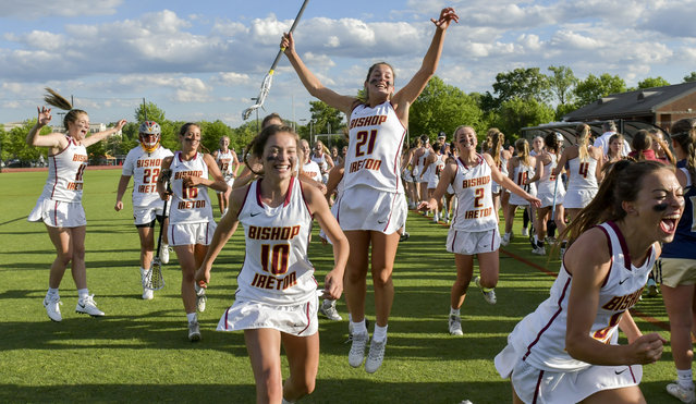Bishop Ireton's Madison Mote (21) leaps for joy as she and her teammates celebrate a 12-4 decision over Good Counsel in the finals of the WCAC girls' lacrosse championship held Monday evening in College Park, MD on May 8, 2017. (Photo by Doug Kapustin/The Washington Post)
