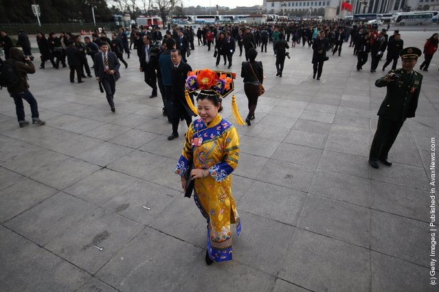 A female ethnic minority delegate wearing a traditional costume arrives at The Great Hall Of The People before the second plenary meeting of the National People's Congress (NPC)