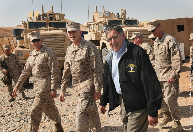 U.S. Secretary of Defense Leon Panetta (R) visits with troops March 14, 2012 at Forward Operating Base Shukvani, Afghanistan