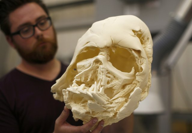 "A technician holds a recently 3D printed replica of Darth Vader's melted helmet from ""Star Wars: The Force Awakens"", in the Propshop headquarters at Pinewood Studios near London, Britain May 25, 2016. (Photo by Peter Nicholls/Reuters)"