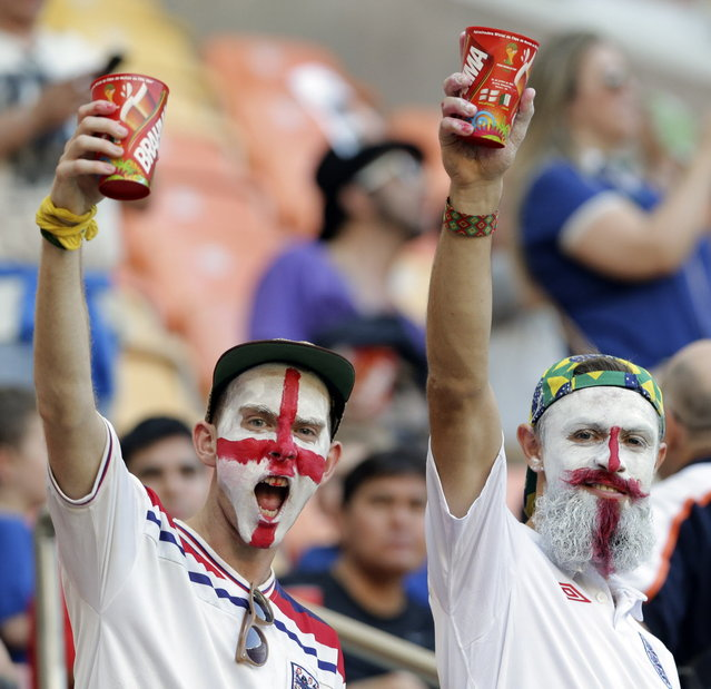 English fans hold up their drinks before the group D World Cup soccer match between England and Italy at the Arena da Amazonia in Manaus, Brazil, Saturday, June 14, 2014. (Photo by Antonio Calanni/AP Photo)