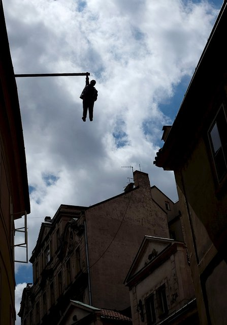 "An installation named ""Man Hanging Out"" by Czech sculptor David Cerny is seen in central Prague, Czech Republic, July 29, 2015. (Photo by David W. Cerny/Reuters)"