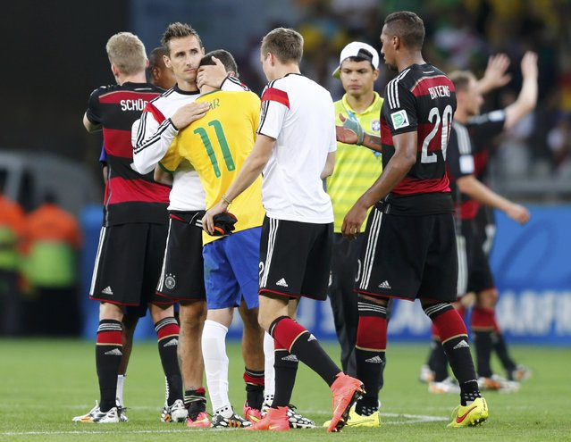 Germany's Miroslav Klose consoles Brazil's Oscar after the 2014 World Cup semi-finals between Brazil and Germany at the Mineirao stadium in Belo Horizonte July 8, 2014. (Photo by Marcos Brindicci/Reuters)