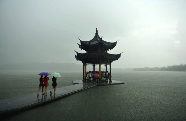 Dark clouds cover Hangzhou City as Typhoon Soudelor approaches on August 7, 2015 in Hangzhou, China. (Photo by ChinaFotoPress via Getty Images)