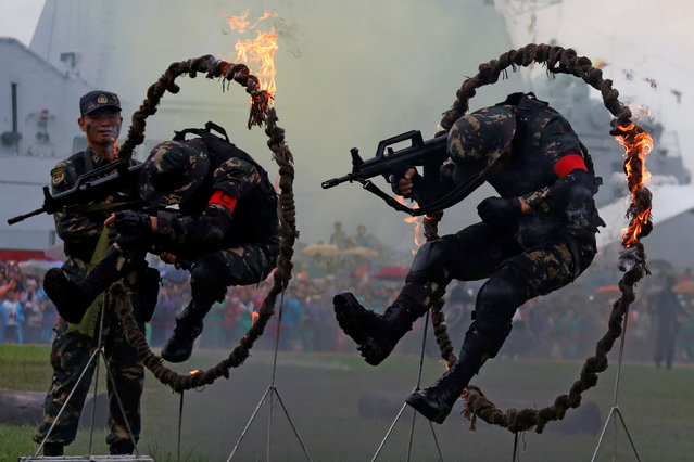 People's Liberation Army soldiers perform during an open day at a naval base in Hong Kong, China July 8, 2017. (Photo by Bobby Yip/Reuters)
