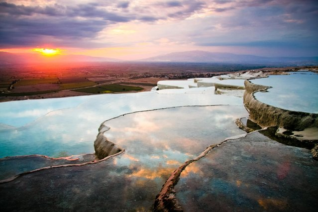 Pamukkale, Turkey, is home to these terrace pools, formed by the build-up of carbonate mineral from the warm water flowing from the thermal springs above. (Photo by Image Courtesy of Jennifer Hayes/Getty Images)