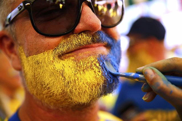 Football Soccer, Euro 2016, Nice, France on June 22, 2016. A Sweden fan sports face paint in Nice, France. (Photo by Wolfgang Rattay/Reuters)