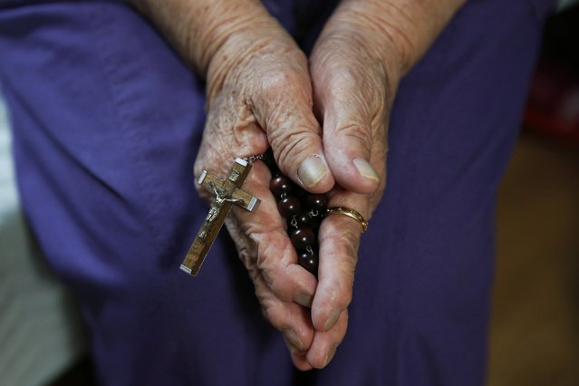 """Former South Korean """"comfort woman"""" Lee Ok-sun, who is a Roman Catholic, holds her crucifix in her room at the """"House of Sharing"""", a special shelter for former """"comfort women"""", in Gwangju, South Korea, July 24, 2015. (Photo by Kim Kyung-Hoon/Reuters)"""