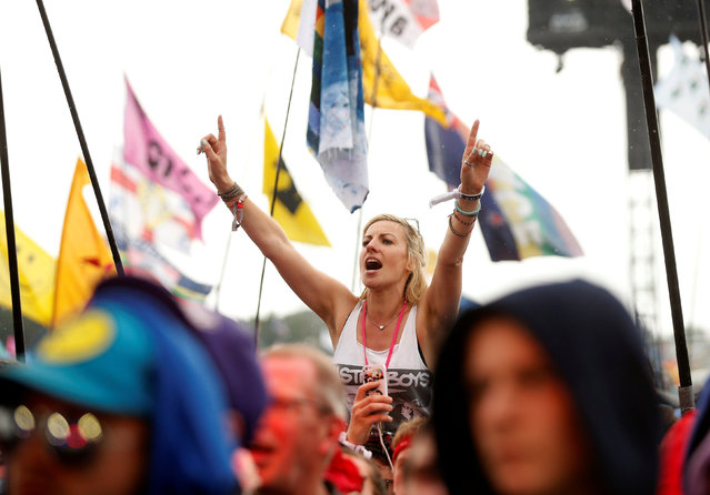 Revellers cheer as Jeff Lynne's ELO perform on The Pyramid stage at Worthy Farm in Somerset during the Glastonbury Festival, Britain, June 26, 2016. (Photo by Stoyan Nenov/Reuters)