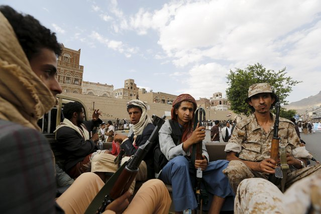 Houthi militants sit on the back of a patrol vehicle as they secure an area where fellow Houthis demonstrated against the Saudi-led air strikes in Yemen's capital Sanaa August 24, 2015. (Photo by Khaled Abdullah/Reuters)