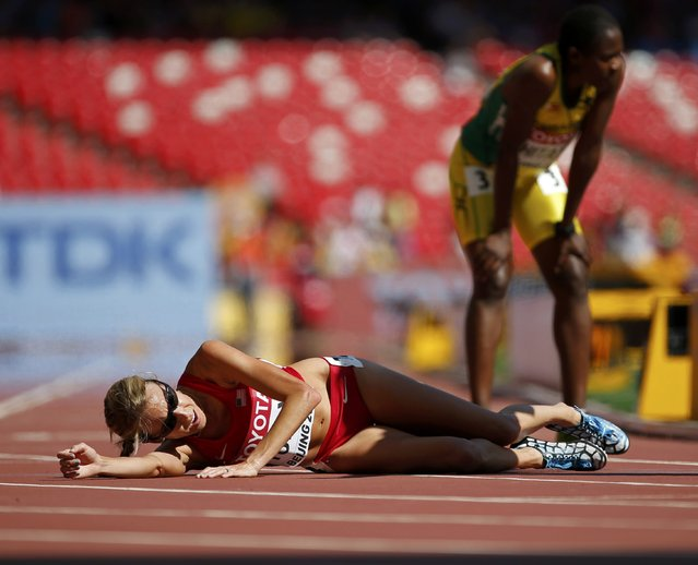 Nicole Tully of the U.S. falls after finishing the women's 5,000 metres heats during the 15th IAAF World Championships at the National Stadium in Beijing, China August 27, 2015. (Photo by Lucy Nicholson/Reuters)