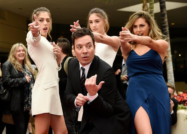 Jimmy Fallon, host of the 74th Annual Golden Globe Awards, poses with Miss Golden Globes 2017, from left, sisters Sistine, Scarlet and Sophia Stallone after rolling out the red carpet during Golden Globe Awards Preview Day at the Beverly Hilton on Wednesday, January 4, 2017, in Beverly Hills, Calif. The awards will be held on Sunday. (Photo by Chris Pizzello/Invision/AP Photo)