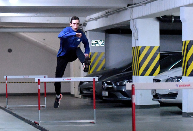 Polish athlete, specialized in the 400 metres and 400 metres hurdles, Patryk Dobek trains in the underground garage at his home during the coronavirus pandemic in Szczecin, Poland, 06 April 2020. Due to the lock-down due to the coronavirus pandemic many athletes do their training routines and exercises at their improvised gym at home. (Photo by Marcin Bielecki/EPA/EFE)