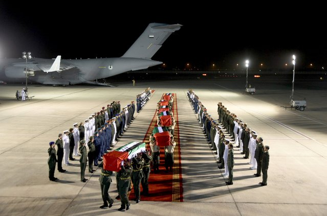 Members of the Emirati armed forces carry coffins containing the bodies of Emirati soldiers, who were killed in Yemen, upon their arrival at Abu Dhabi international airport in this handout photo provide by United Arab Emirates News Agency WAM on September 5, 2015. (Photo by Reuters/United Arab Emirates News Agency WAM)