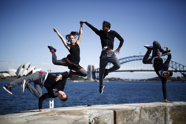 Members of the Red Bull Flying Bach dance troupe perform on Sydney Harbour's Fort Denison during a photo call, in Sydney September 9, 2014. The group, in Australia as part of their world tour, perform acrobatic dance to the classical music of German composer Johann Sebastian Bach with combined with electronic beats. Pictured are (L-R) Tim Mandriamanantena, Anna Holmstrom, Nordine-Dany Grimah and Yamine Manaa. (Photo by Jason Reed/Reuters)