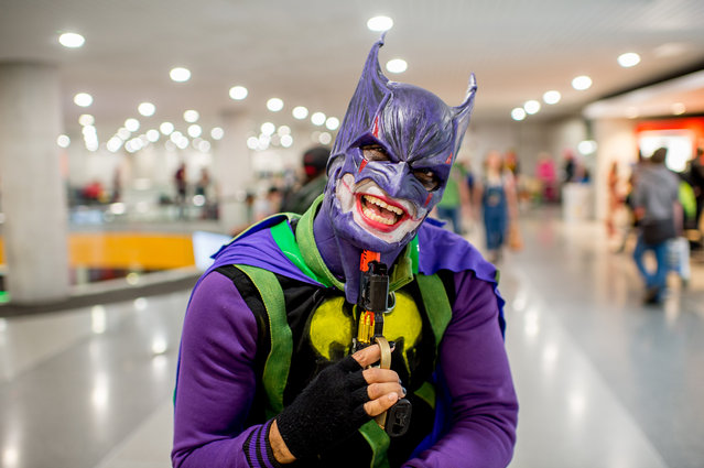 A fan cosplays as Joker Batman during the 2017 New York Comic Con, Day 4 on October 8, 2017 in New York City. (Photo by Roy Rochlin/WireImage)