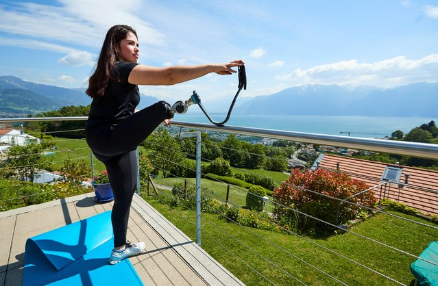 Paralympic athlete Sofia Gonzalez trains in her home garden during the outbreak of the coronavirus disease (COVID-19) in Jongny, Switzerland, May 19, 2020. (Photo by Denis Balibouse/Reuters)