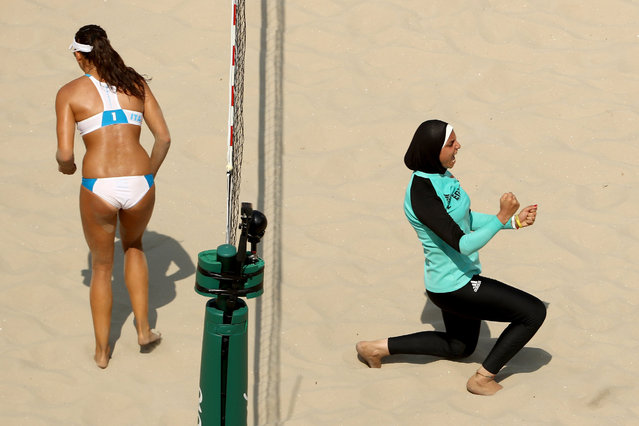 Doaa Elghobashy of Egypt celebrates while Marta Menegatti of Italy walks away during the Women's Beach Volleyball Preliminary Pool A match on Day 4 of the Rio 2016 Olympic Games at the Beach Volleyball Arena on August 9, 2016 in Rio de Janeiro, Brazil. (Photo by Ezra Shaw/Getty Images)
