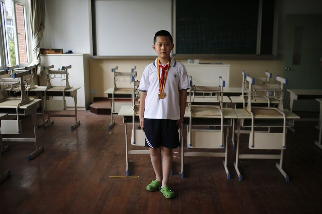 "Only child Wang Qi'an, who was born in 2003, poses for a photograph in Shanghai August 15, 2014.  When asked if he would like to have siblings, Qi'an said: ""No because I have investigated all my classmates who have brothers or sisters. None of them perform well in their studies"". (Photo by Carlos Barria/Reuters)"