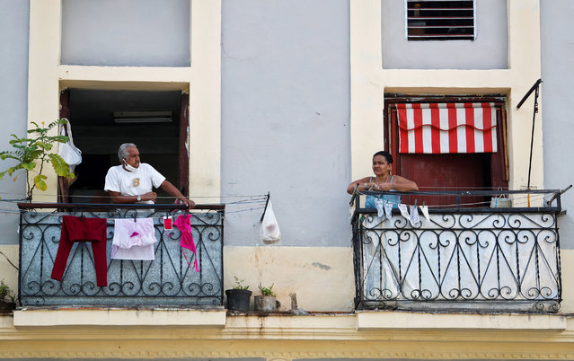 People stand on their balconies amid the ongoing coronavirus COVID-19 pandemic in Havana, Cuba, 18 June 2020. Countries around the world are taking measures to stem the widespread of the SARS-CoV-2 coronavirus which causes the COVID-19 disease. (Photo by Yander Zamora/EPA/EFE/Rex Features/Shutterstock)