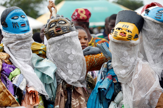 Masquerade performers participate in the annual Badagry cultural festival near the old slave port in Badagry, on the outskirts of Lagos, Nigeria August 27, 2016. (Photo by Akintunde Akinleye/Reuters)