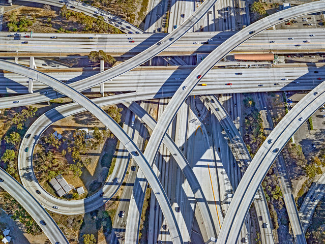 Photographer Jeffrey Milstein explores residential and commercial neighbourhoods, parks and recreation spots, and industrial districts of LA and New York using a high-resolution camera from a helicopter. Here: Judge Harry Pregerson interchange, Los Angeles. The stack interchange, which combines the Glenn M Anderson and Harbor freeways, was opened in 1993 and is 40 metres high at its highest point. (Photo by Jeffrey Milstein/The Guardian)