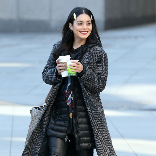 """Actress Vanessa Hudgens walks to set with two cups of coffee filming """"Second Act"""" in New York City, New York on November 28, 2017. (Photo by Christopher Peterson/Splash News and Pictures)"""