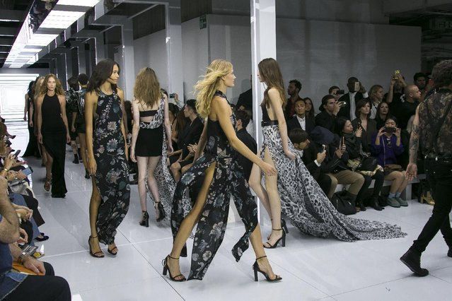 Models wear outfits by designer Versus during the Spring/Summer 2016 show for London Fashion Week at Victoria House in central London, Saturday, September 19, 2015. (Photo by Joel Ryan/Invision/AP Photo)