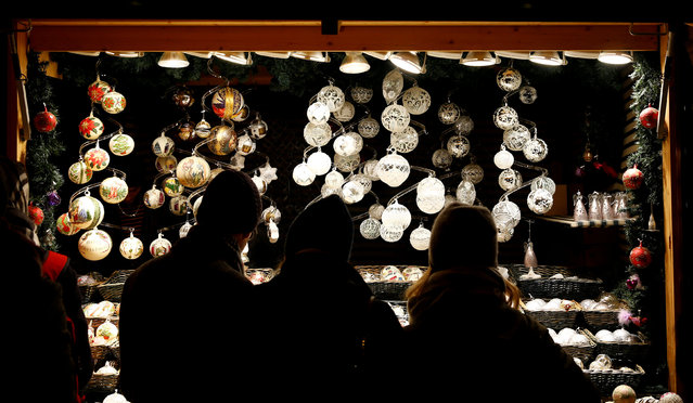 People look at Christmas decorations at a Christmas market in front of the Schoenbrunn palace in Vienna, Austria, December 3, 2017. (Photo by Leonhard Foeger/Reuters)