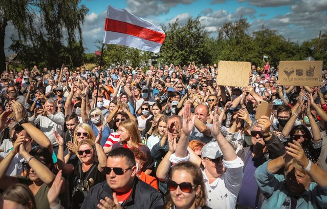 Belarusians attend a meeting in support of Svetlana Tikhanovskaya, candidate for the presidential elections, in Hlybokaje, Belarus, Friday, July 24, 2020. On Friday, 3,000 people turned out at an opposition gathering in Novopolotsk, north of the Belarusian capital. And in the town of Hlybokaje, which has a population of 18,000, more than 1,000 attended Tilkhanovskaya's campaign rally. The presidential election in Belarus is scheduled for August 9, 2020. (Photo by AP Photo/Stringer)