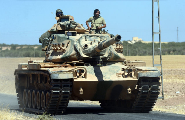 In this photo taken on Friday, September 2, 2016, A Turkish tank heads to the Syrian border, in Karkamis, Turkey. Turkish troops and allied Syrian rebels expelled the Islamic State group from the last strip of territory it controlled along the Syrian-Turkish border on Sunday, effectively sealing the extremists' self-styled caliphate off from the outside world, Turkey's state-run news agency reported. (Photo by Ismail Coskun/IHA via AP Photo)