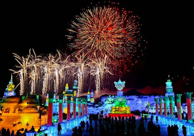 Visitors watch fireworks during the official opening of the 29th Harbin International Ice and Snow Festival on January 5, 2013. (Photo by Associated Press)