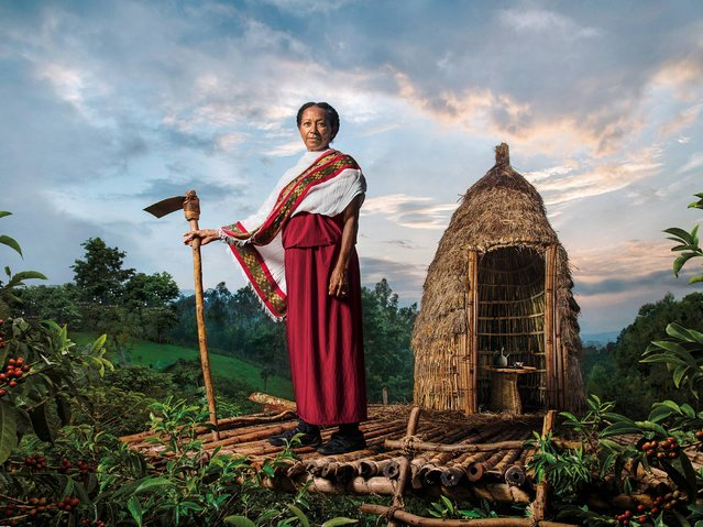 """""""The Sentinel Guarding the Plantations"""". Asnakech Thomas, a coffee grower in Ethiopia, the homeland of coffee, she is a determined and passionate guardian of the Ethiopian Arabica coffee she calls """"green gold"""" and regards as the """"backbone"""" of her country. (Photo by Steve McCurry/2015 Lavazza Calendar)"""