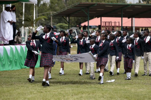 Students of the Pacesetters Academy march in a parade at the Old Parade ground during celebrations to commemorate Nigeria's 55th Independence Day in Abuja, Nigeria, October 1, 2015. (Photo by Afolabi Sotunde/Reuters)