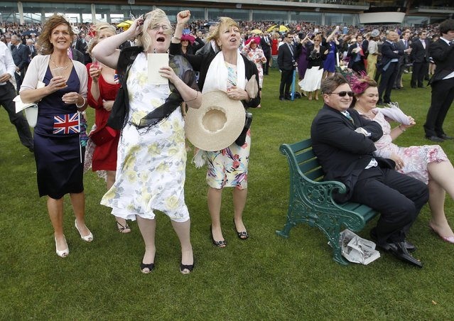 Racegoers watch their horses on the fourth day at Royal Ascot, southwest of London, June 22, 2012. (Photo by Andrew Winning/Reuters)