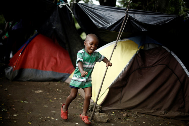 An African migrant boy runs at a makeshift camp at the border between Costa Rica and Nicaragua, in Penas Blancas, Costa Rica, September 7, 2016. (Photo by Juan Carlos Ulate/Reuters)