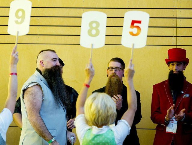 Participants are judged during the 2015 World Beard and Moustache Championships in Leogang, Austria, 03 October 2015. (Photo by Angelika Warmuth/EPA)
