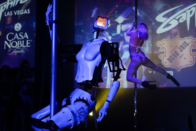 A pole-dancing robot built by British artist Giles Walker performs at a gentlemen's club Monday, January 8, 2018, in Las Vegas. The event was held to coincide with CES International. (Photo by Jae C. Hong/AP Photo)
