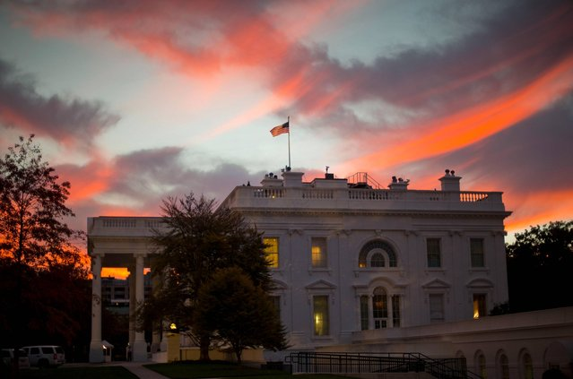 Early morning sunrise is seen over the White House in Washington, Tuesday, October 28, 2014. (Photo by Pablo Martinez Monsivais/AP Photo)