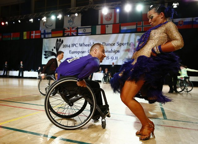 Pawel Karpinski and Nadine Kinczel of Poland dance as they compete during IPC Wheelchair Dance Sport European Championships in Lomianki near Warsaw, November 9, 2014. (Photo by Kacper Pempel/Reuters)