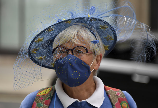 A pro EU protester is seen at the Westminster Conference Centre in London, Wednesday, September 9, 2020. UK and EU officials begin the eighth round of Brexit negotiations in London. (Photo by Alberto Pezzali/AP Photo)