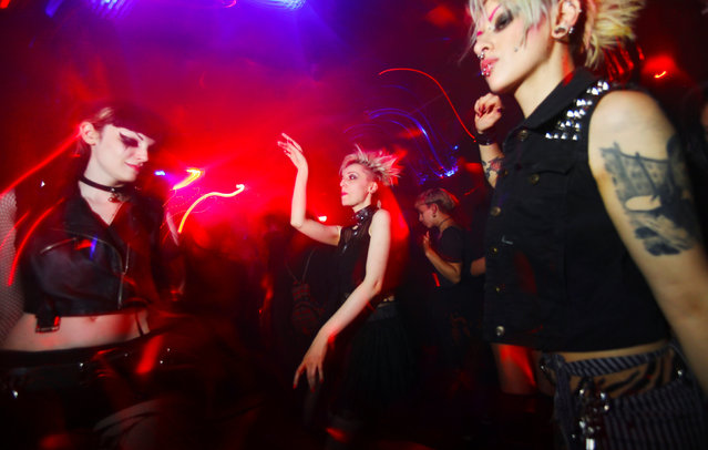 Women dance at Duncker Club in Berlin, Germany, August 30, 2016. The women were Italian musicians who live in Berlin and were celebrating a birthday at the club. One of them is a singer in a Berlin punk band. (Photo by Hannibal Hanschke/Reuters)