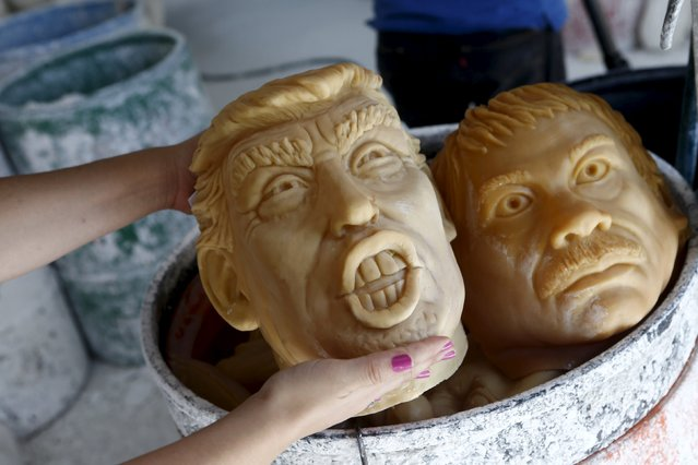 "An employee shows a Republican presidential candidate Donald Trump (L) and Joaquin ""El Chapo"" Guzman masks at Grupo Rev in the Mexican city of Cuernavaca near Mexico City, October 14, 2015. (Photo by Henry Romero/Reuters)"