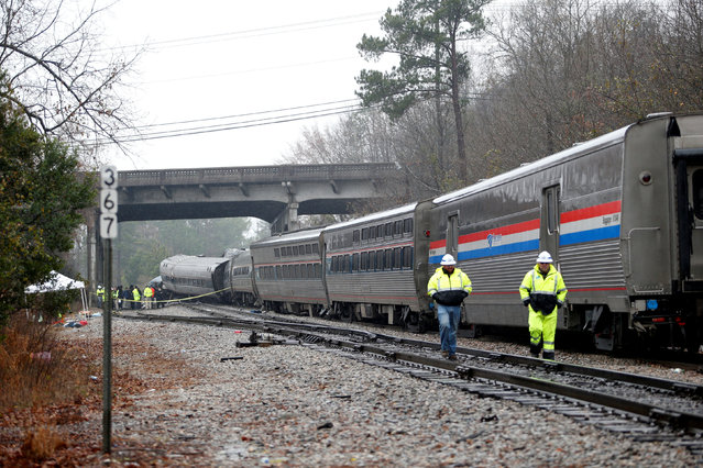 Emergency responders are at the scene after an Amtrak passenger train collided with a freight train and derailed in Cayce, South Carolina, U.S., February 4, 2018. (Photo by Randall Hill/Reuters)